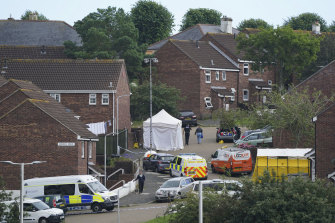 Forensic officers work in the Keyham area of Plymouth, England, on Friday.