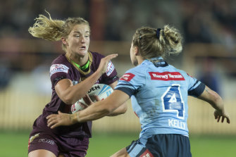 Queensland's Meg Ward is tackled by NSW's Isabelle Kelly during last year's Women's State of Origin match.