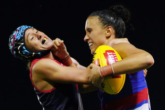 Melbourne's Aliesha Newman tackles Bailey Hunt of the Bulldogs.