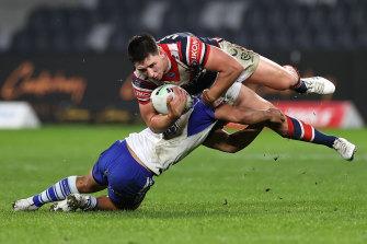 Victor Radley is tackled in midair at Bankstown Stadium.