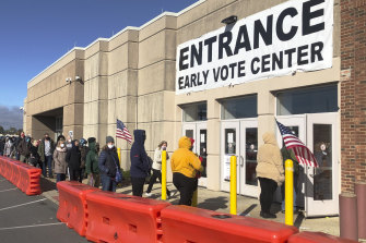 People line up to cast early votes in Columbus, Ohio.