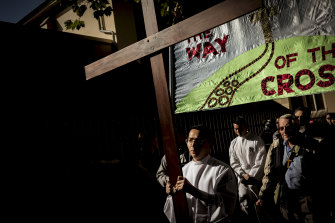Members of Melbourne churches take part in the Stations of the Cross walk.