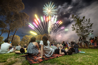 Families watch the New Year's Eve fireworks in Melbourne in 2015.