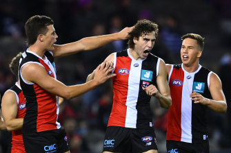 King is congratulated by team-mates after kicking a goal during Friday's clash against the Cats.