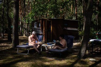 Nudists relax at a camp in Zossen, Germany.