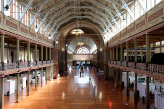 People attend the mass vaccination hub at the Royal Exhibition Building.