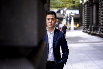 Melbourne City councillor Philip Le Liu was abused while carrying a box of face masks.