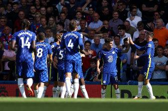 Christian Pulisic celebrates a goal with Chelsea teammate Mason Mount.