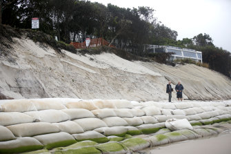 Sandbags protect Beach Byron Bay Cafe after severe erosion on the beach.