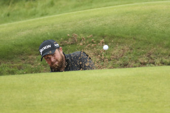 Shane Lowry plays out of a bunker on the 13th green during the final round of the Open at Royal Portrush in Northern Ireland on Sunday.
