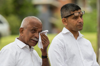 Prabha Kumar's father, Mahabala Shetty, and brother at the service in 2015.