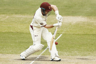Queensland's Jimmy Peirson bats on day three.