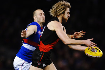 Tory Dickson of the Bulldogs tackles Bomber Dyson Heppell, their only decent player of the night.