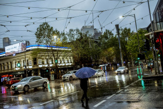 Melbourne woke to a wet Monday morning, with 14 days to get average daily case numbers down to five in order for further lockdown restrictions to be eased.