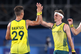 Tim Brand celebrates with teammate Tim Howard after scoring the Kookaburras' seventh goal during the Men's Preliminary Pool A match between India and Australia on day two of the Tokyo Olympics.