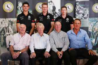 Terry Waters, front left, with Collingwood greats past and present in 2014.