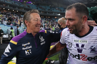 Back on top ... Craig Bellamy and Cameron Smith at ANZ Stadium on Sunday night.