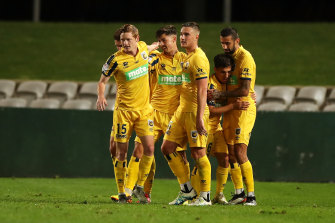 Dylan Ruiz-Dias (centre) celebrates with his teammates after scoring a goal against Melbourne Victory.