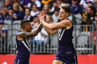 Matt Taberner (right) and Michael Walters celebrate a goal against the Hawks at Optus Stadium.