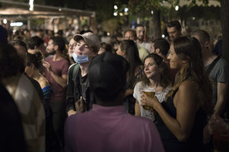 "People gather at a bar in Marseille, southern France on September 12  as French Prime Minister Jean Castex warned that the virus situation is ""obviously worsening"" in the country."