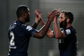 Suliasi Vunivalu celebrates with Cameron Smith.