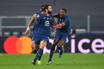 Sergio Oliveira celebrates after scoring a crucial late goal against Juventus.