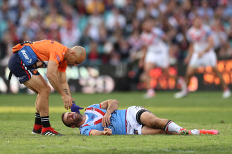 James Tedesco receives assistance after being floored by Jordan Pereira.