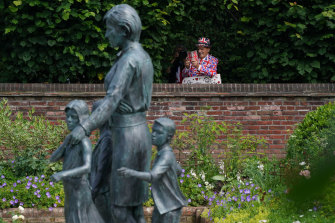 Members of the public view the statue of Diana, Princess of Wales, in the Sunken Garden at Kensington Palace.
