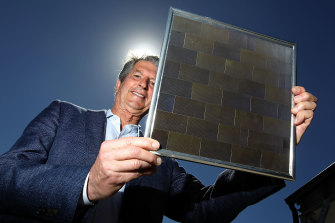 UNSW's Professor Martin Green, a solar energy pioneer, holds the world's first 23 per cent efficient solar module developed back in 1999. (Photograph from December 2017.)