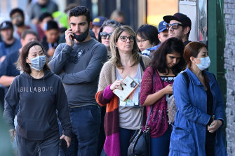 The nation must decide its best path forward: People lining up at a Centrelink office amid the COVID-19 shock.