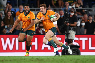 Andrew Kellaway of the Wallabies dives over to score a try.