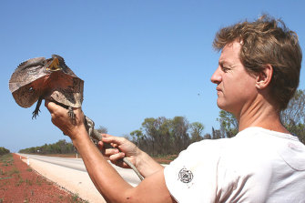 Geraldton reptile enthusiast and breeder David Mackintosh with a frill-necked lizard, one of the many Australian species sought by overseas buyers.