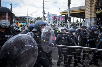 Police face protesters on Tuesday.