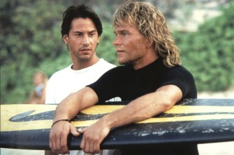Keanu Reeves (left) and Patrick Swayze in a famous scene from their ironically iconic film.