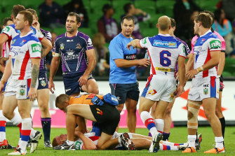 Alex McKinnon on the ground after the tragic tackle in 2014 in Melbourne.