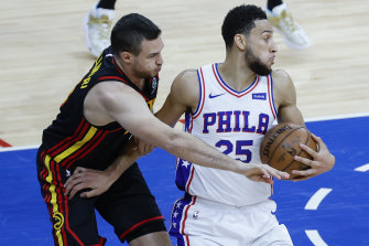 Atlanta's Danilo Gallinari tries to steal the ball from Ben Simmons.
