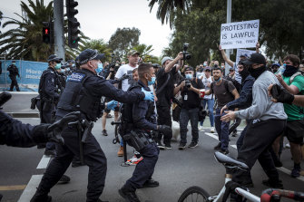 Police and protesters clashed at the 'Freedom Day' protest outside the NGV.