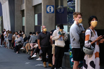 People line up outside the Royal Melbourne Hosital for coronavirus testing.
