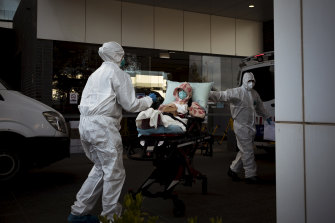 A patient is taken from Epping Gardens Aged Care on Tuesday.