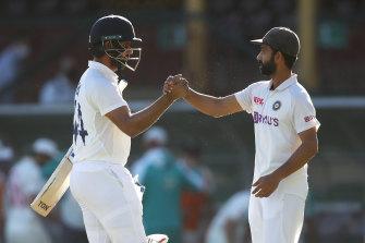 Hanuma Vihari shakes hands with his captain Ajinkya Rahane at stumps.