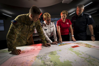 Sergeant Ryan Hodgson from the Australian Army, Deputy Emergency Management Commissioner Deb Abbott, the Red Cross' Kate Siebert and  Victoria Police Inspector Craig Shepherd.