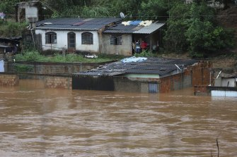 A view of flooded houses caused by heavy rains in Sabara municipality, Minas Gerais state, Brazil on Friday.