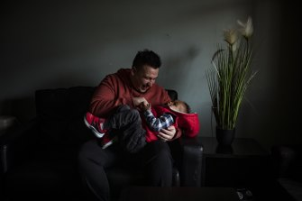 Formerly homeless youth Luis Montero with his son Andre.