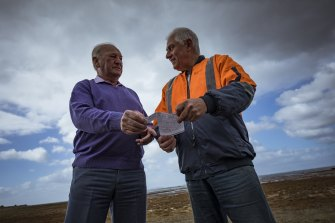 Retired salvage diver, Rod Knights (left) speaks with Kevin Hynes, the last living witness to the crashed Wirraway aircraft.