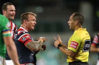 Jake Friend remonstrates with referee Ashley Klein during the Roosters' loss to Canberra on Friday.