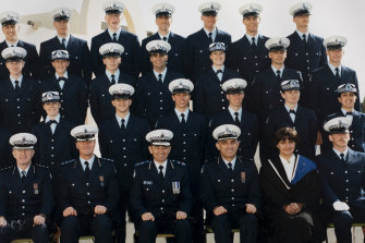 Michael Tarulli (second row from front, fourth from right) graduates as a police officer.