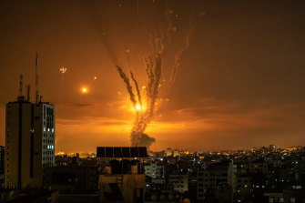 Rockets launched towards Israel from the northern Gaza Strip and response from the Israeli missile defence system streaks through the sky.