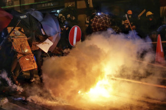 Tear gas canisters are fired at protesters on the streets of Hong Kong on Sunday night.