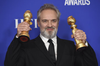 Sam Mendes poses with the awards for best director and best motion picture, drama for 1917.