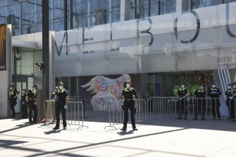 Police line the entrances of the vaccination hub at the Melbourne Museum.